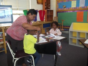 Ms. Penelton assisting students during lesson